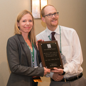 Jame Walker accepting Lipsitt award from Jeff Huffman, 2018